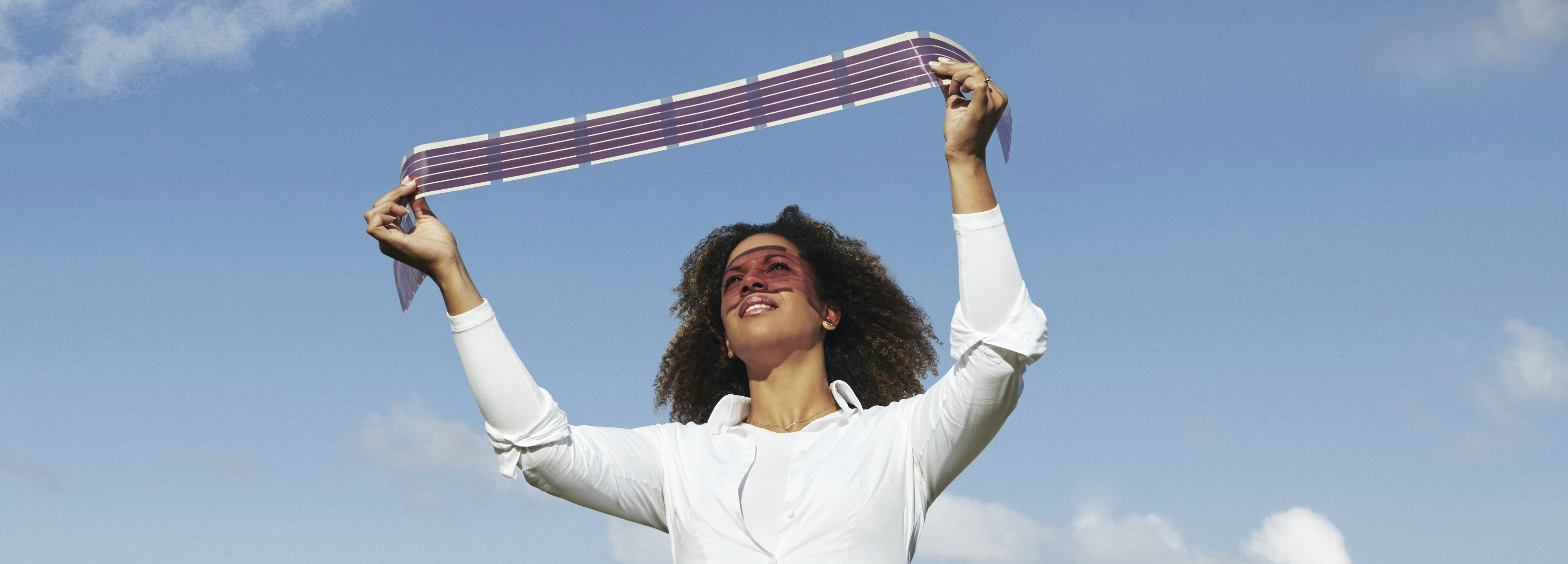 Oman holding up new printable solar cells that are flexible, light weight and are so thin that they can cover most surfaces.
