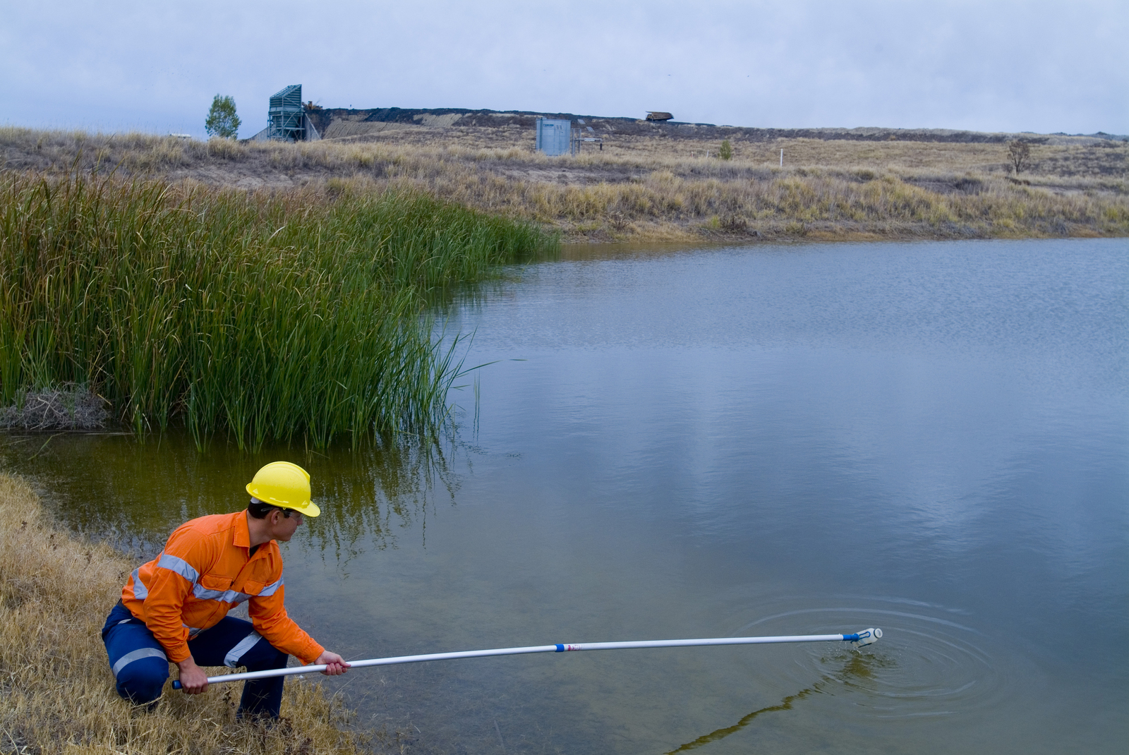 Worker monitoring mine tailings
