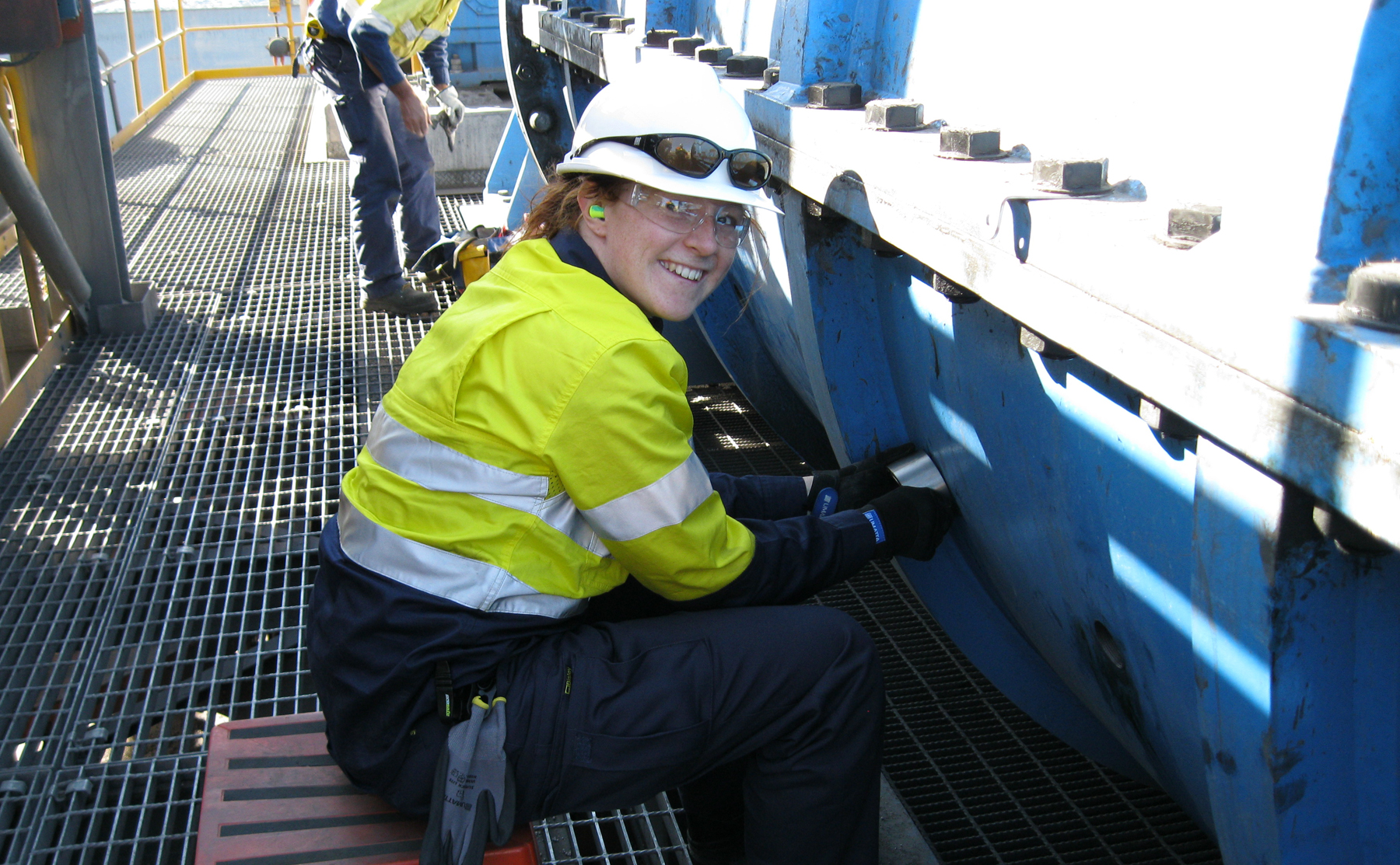 Young female engineer placing acoustic analyser on equipment
