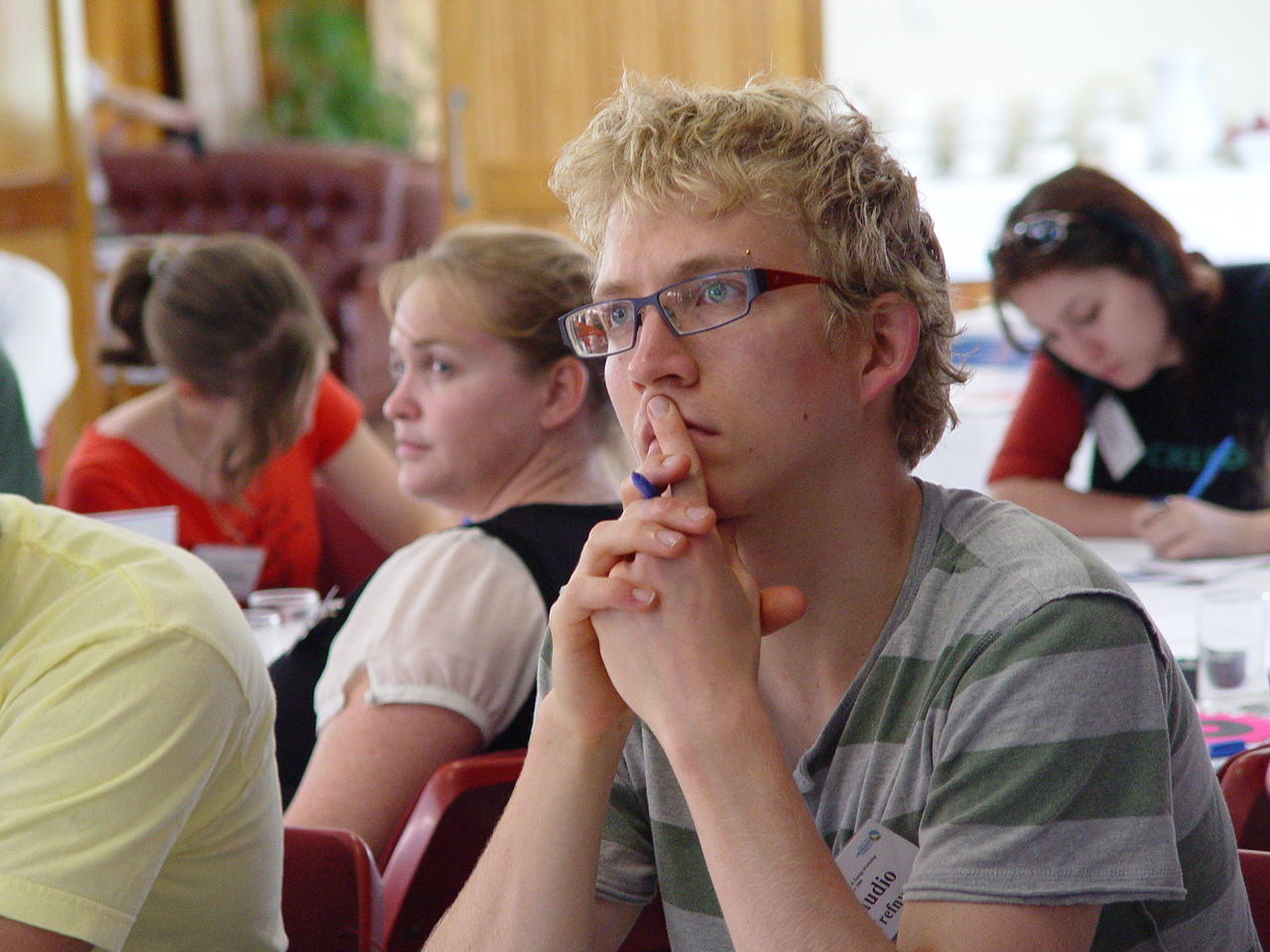 Close up of a person in a focus group listening to information being delivered by social researcher