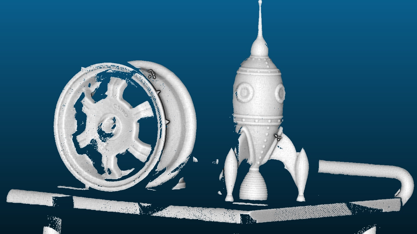 car wheel rim and rocket shaped object