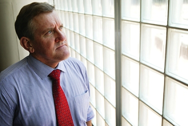 The Honourable Ian Macfarlane, Minister for Industry looking out of a window
