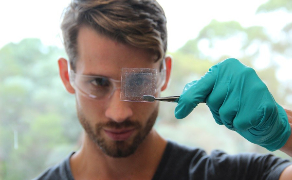 Scientist looking at a thin film of graphene