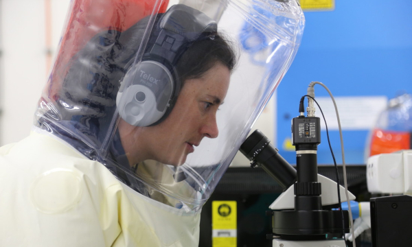 researcher in hazmat suit working at AAHL
