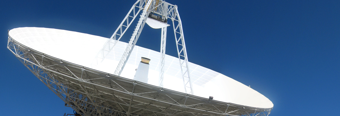 Canberra Deep Space Communication Complex dish against a blue sky