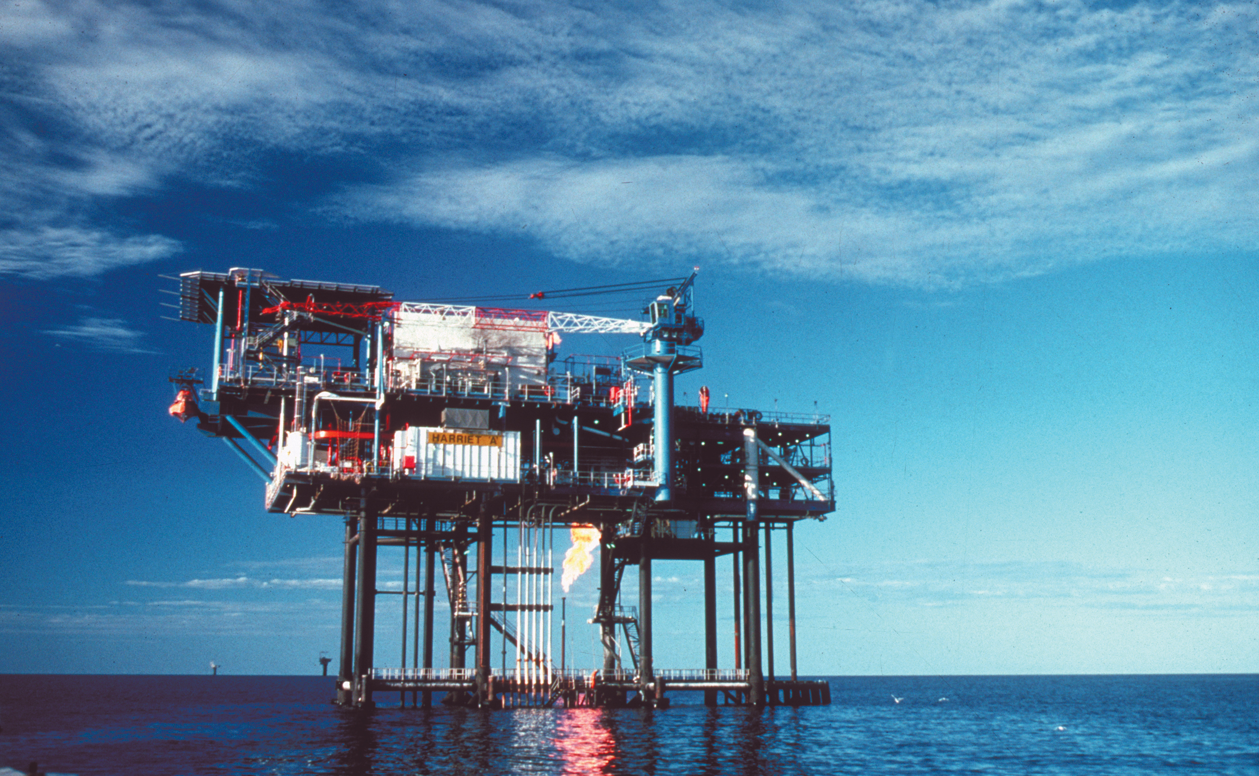 An offshore oil rig surrounded by ocean.