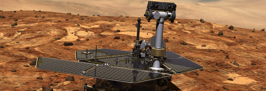 Mars rover robot on red soil with hills in the background