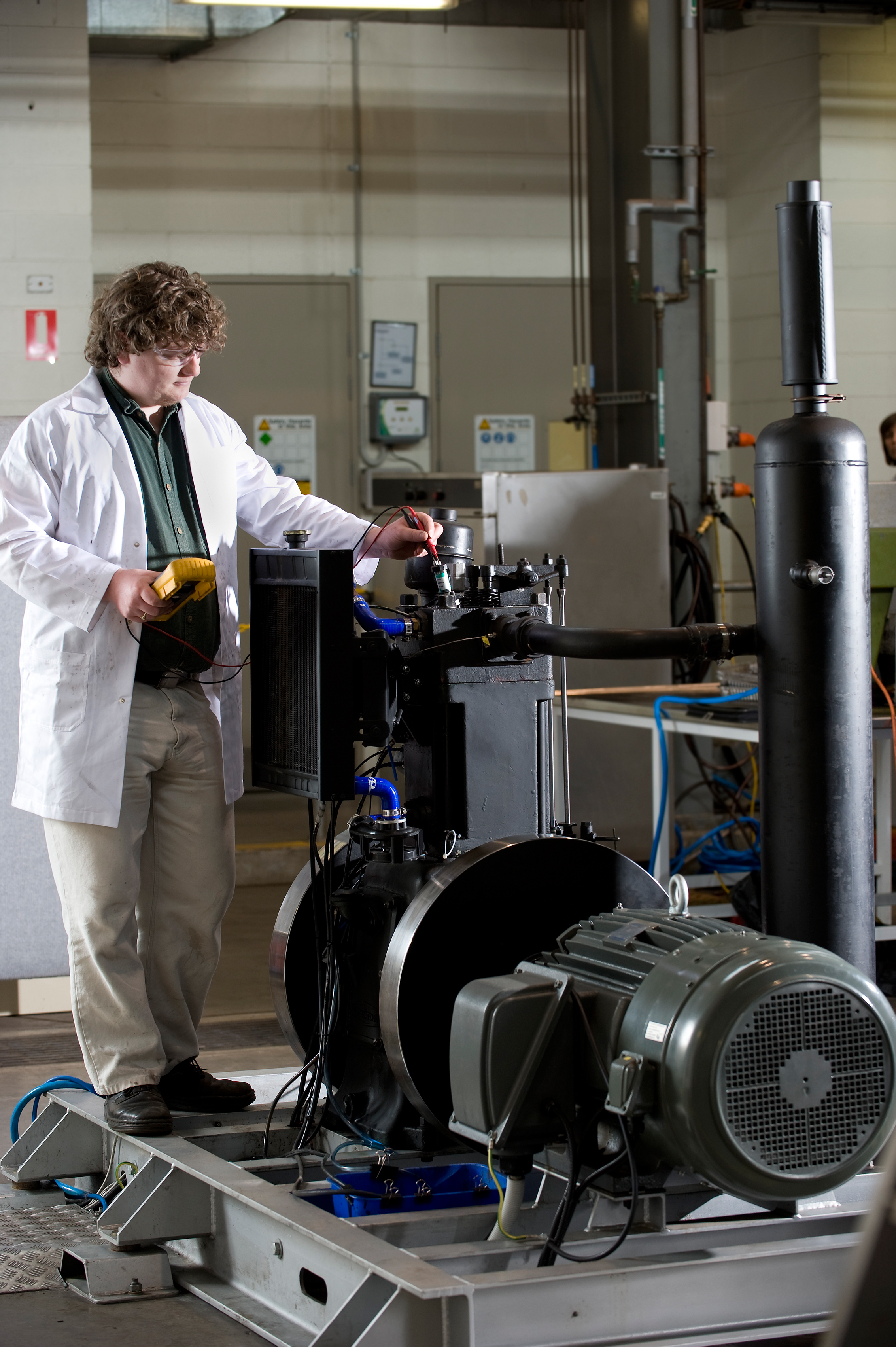 A researcher tests the Direct Injection Carbon Engine