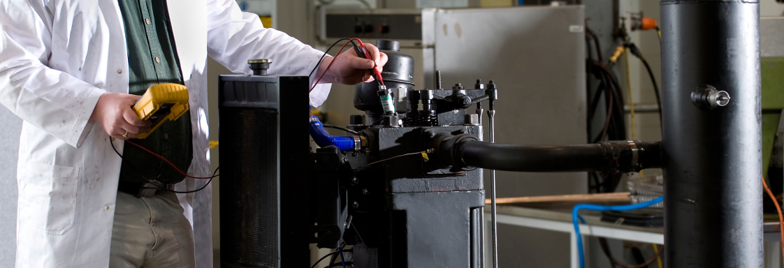 A researcher tests the Direct Injection Carbon Engine in the lab