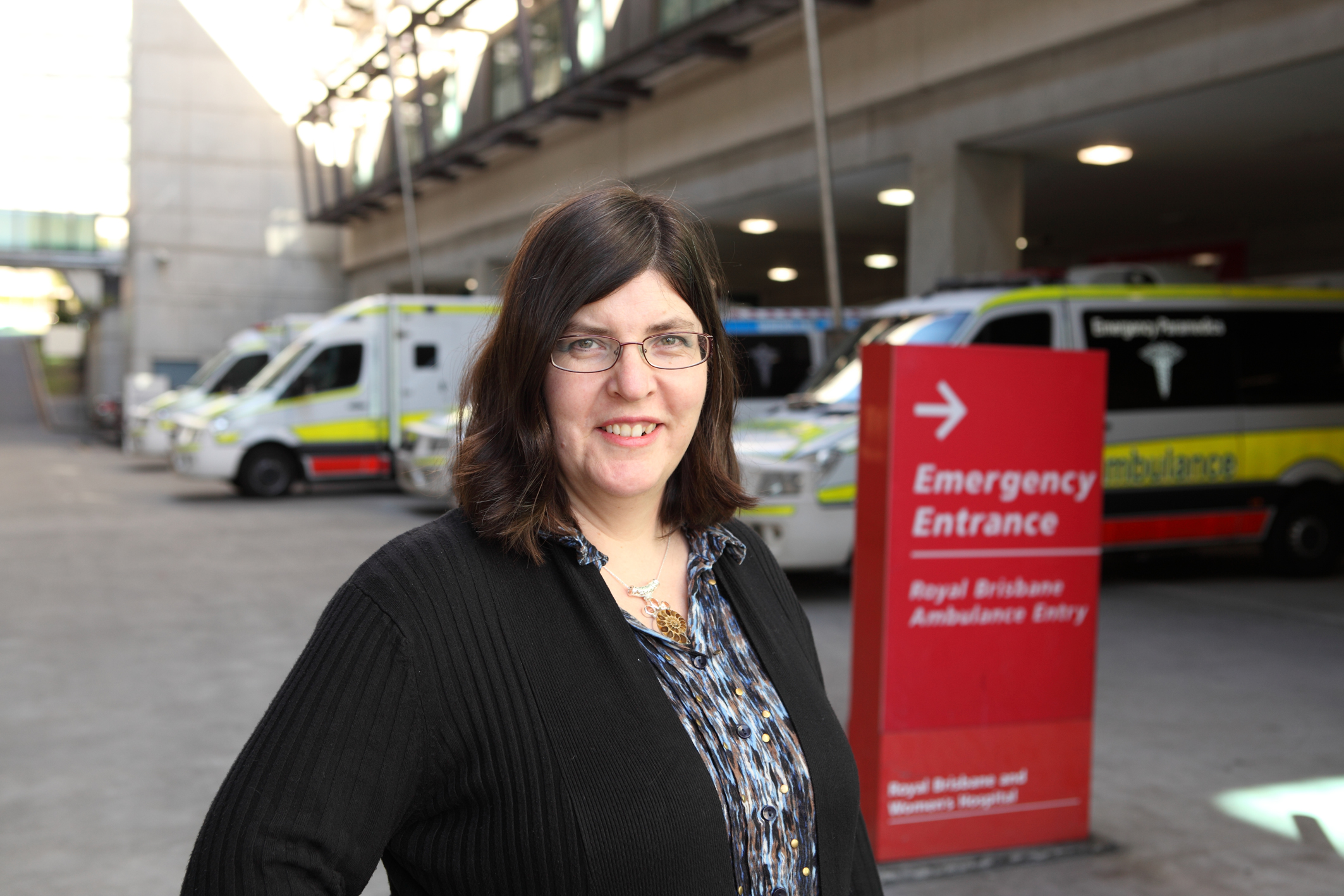 Dr Sarah Dods stands outside an Emergency department in a major hospital