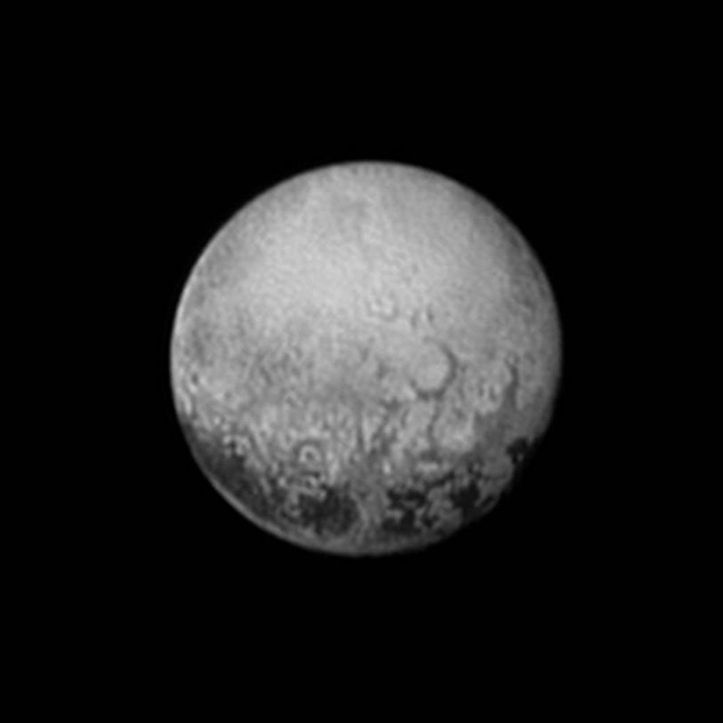 Pluto showing dark spots