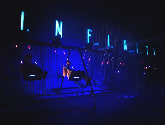 Infinity swing at night.