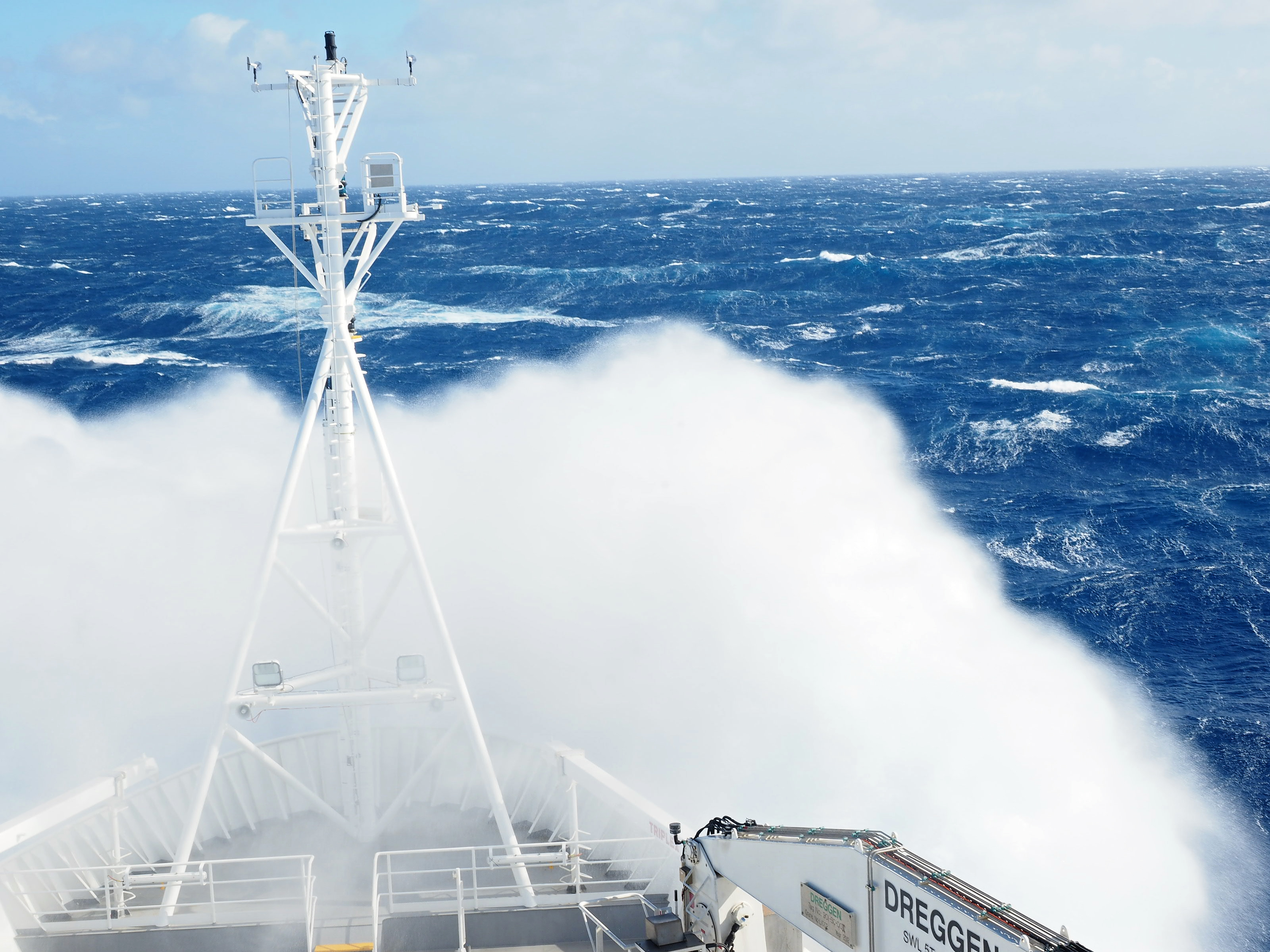 Wave crashing over the front of the RV Investigator as it moves through the Southern Ocean.