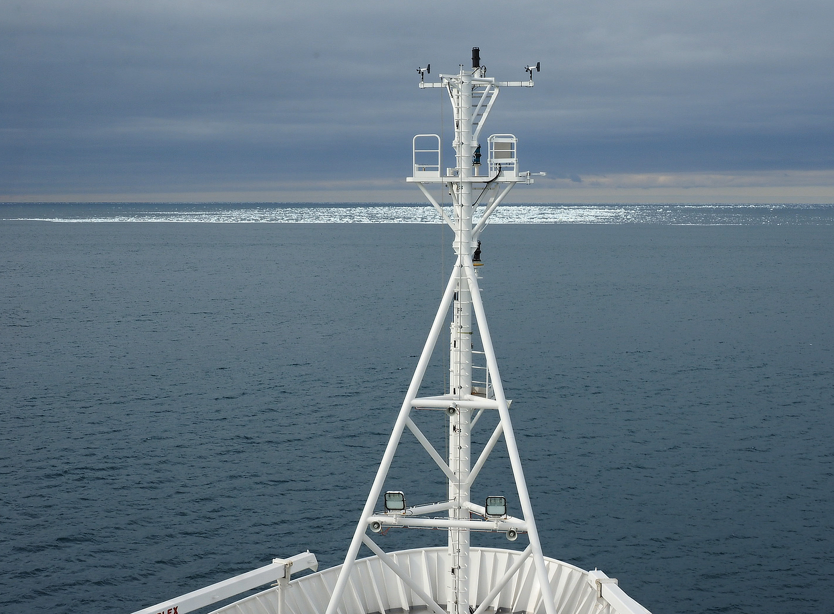 Looking across the front of RV Investigator with the Antarctic ice edge in the distance.