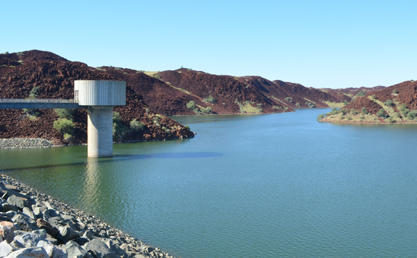 A tower stands above the water level at the Harding Dam in WA.