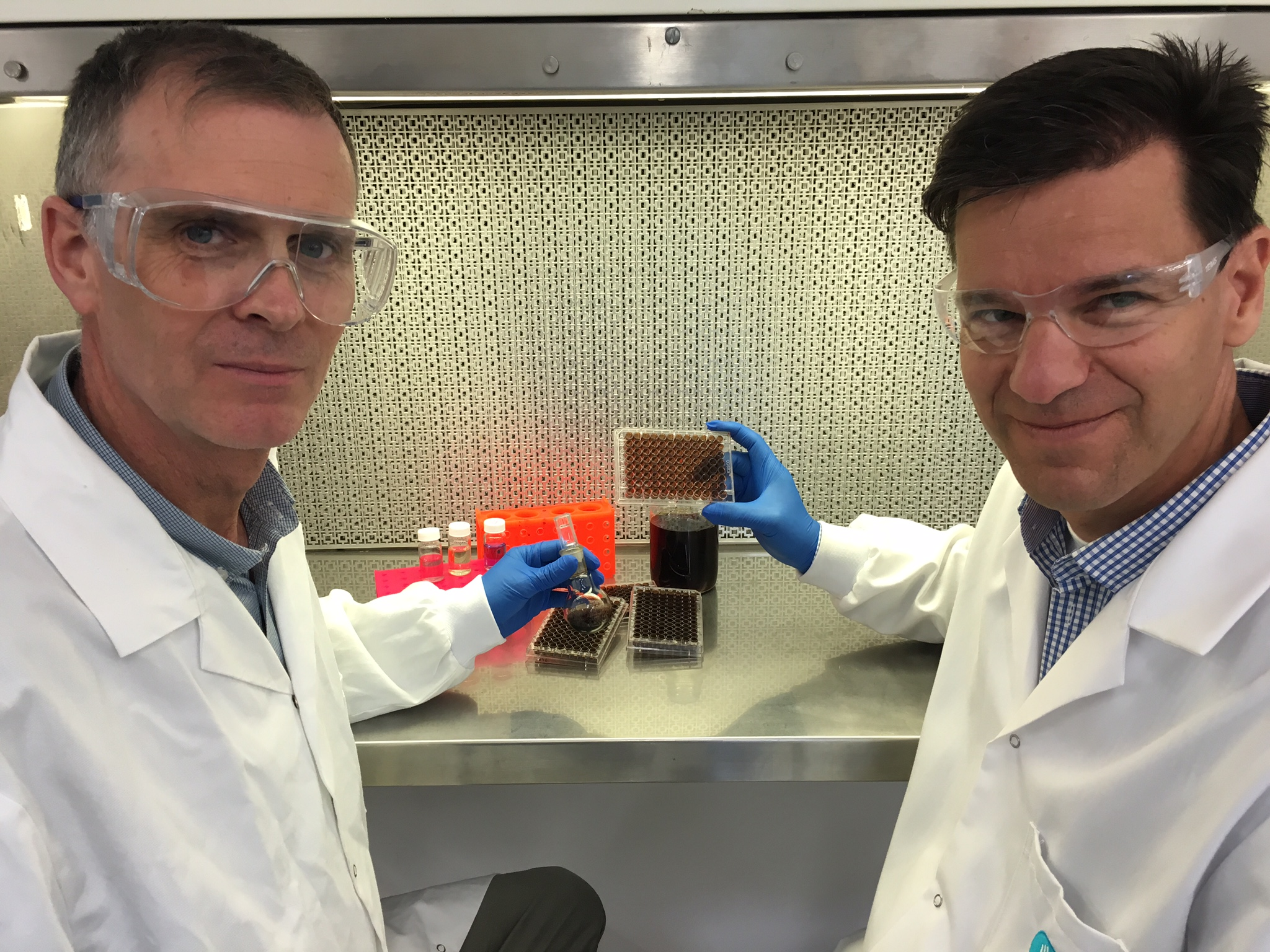 Dr Richard Evans and Dr Helmut Thissen holding lab equipment.