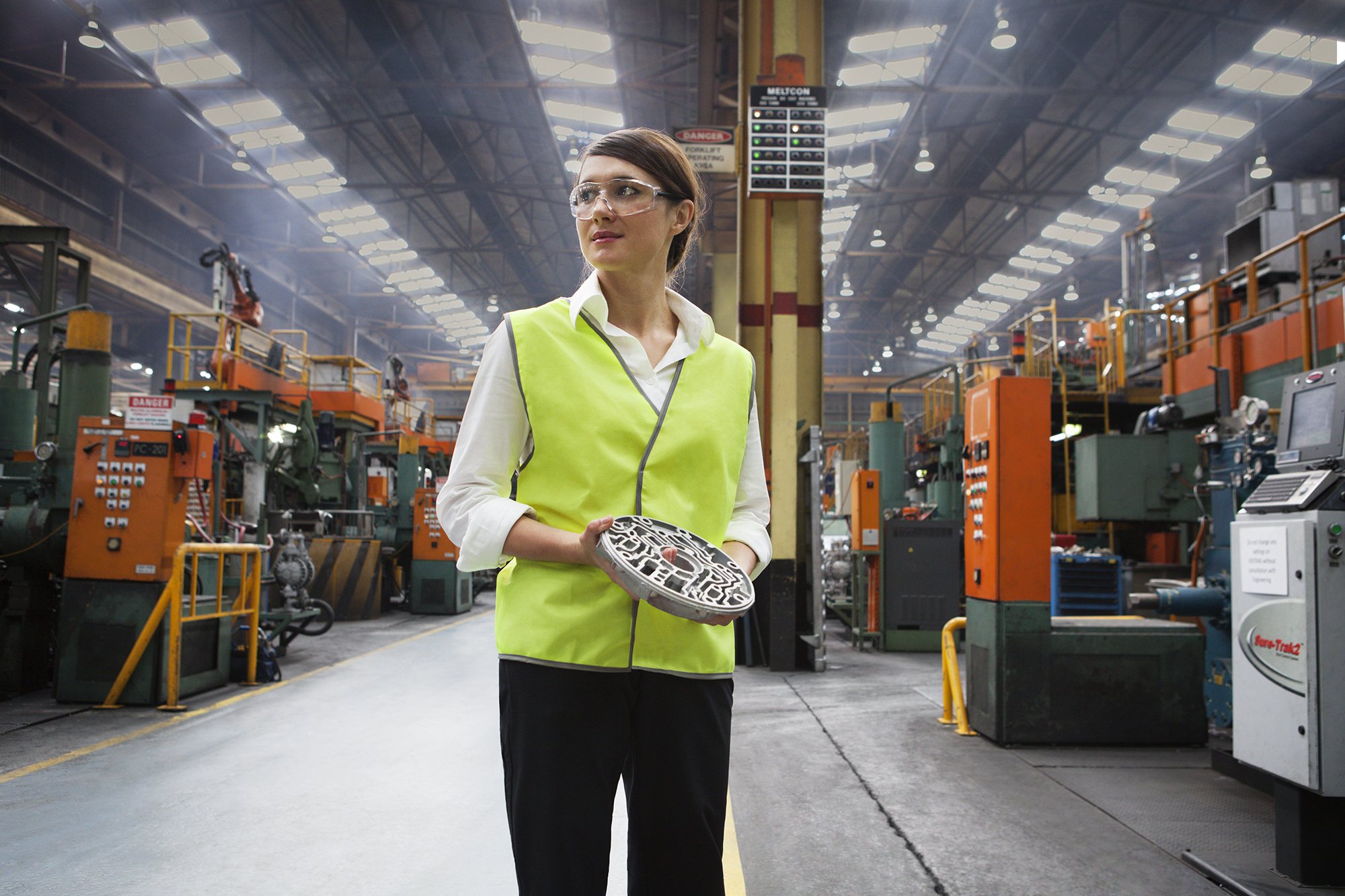A woman wearing safety glasses and a high visibility vest at Nissan's plant in Melbourne.