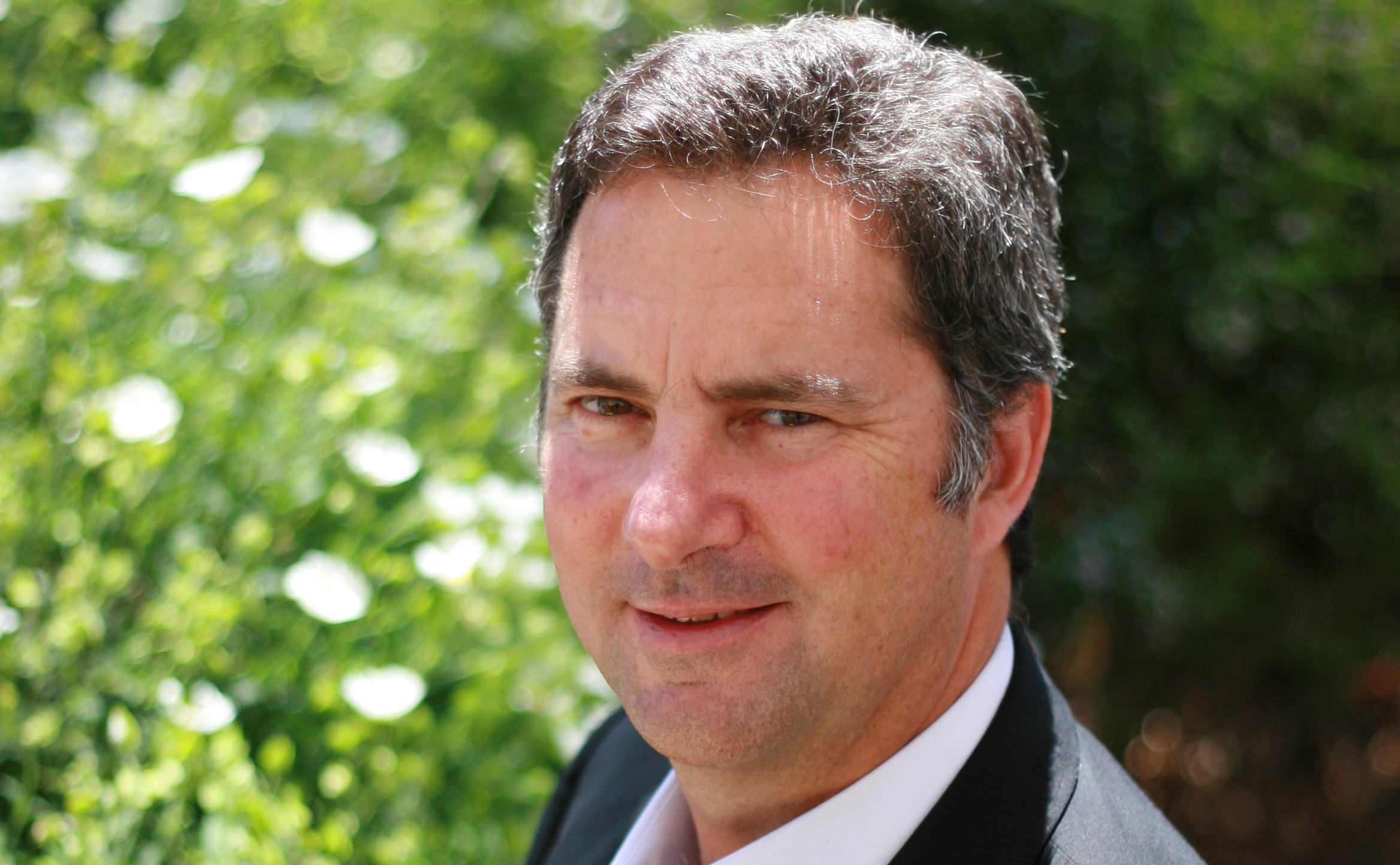 Dr Larry Marshall, CSIRO Chief Executive in a garden