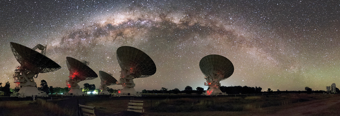 CSIRO's Compact Array in Australia under the night lights of the Milky Way.