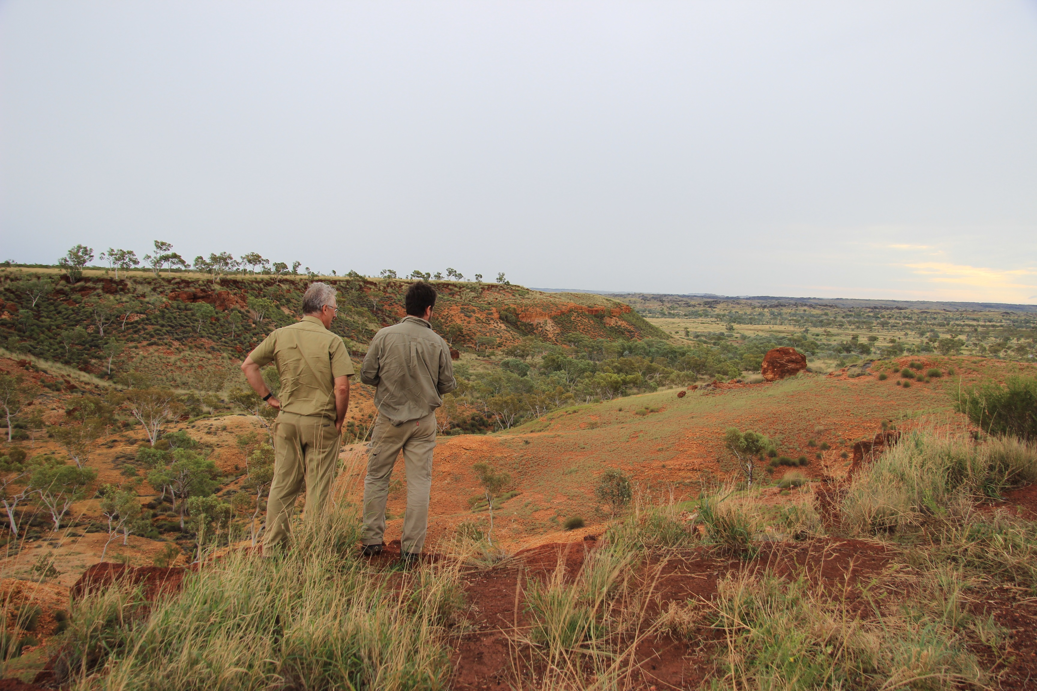 Dr Mark Thomas and Noel Schoknecht standing on escarpment looking towards the Fitzroy catchment in Western Australia.