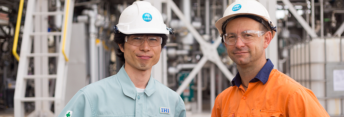 IHI Corporation's Jun Arakawa and CSIRO's Aaron Cottrell in front of the PICA post-combustion capture project.