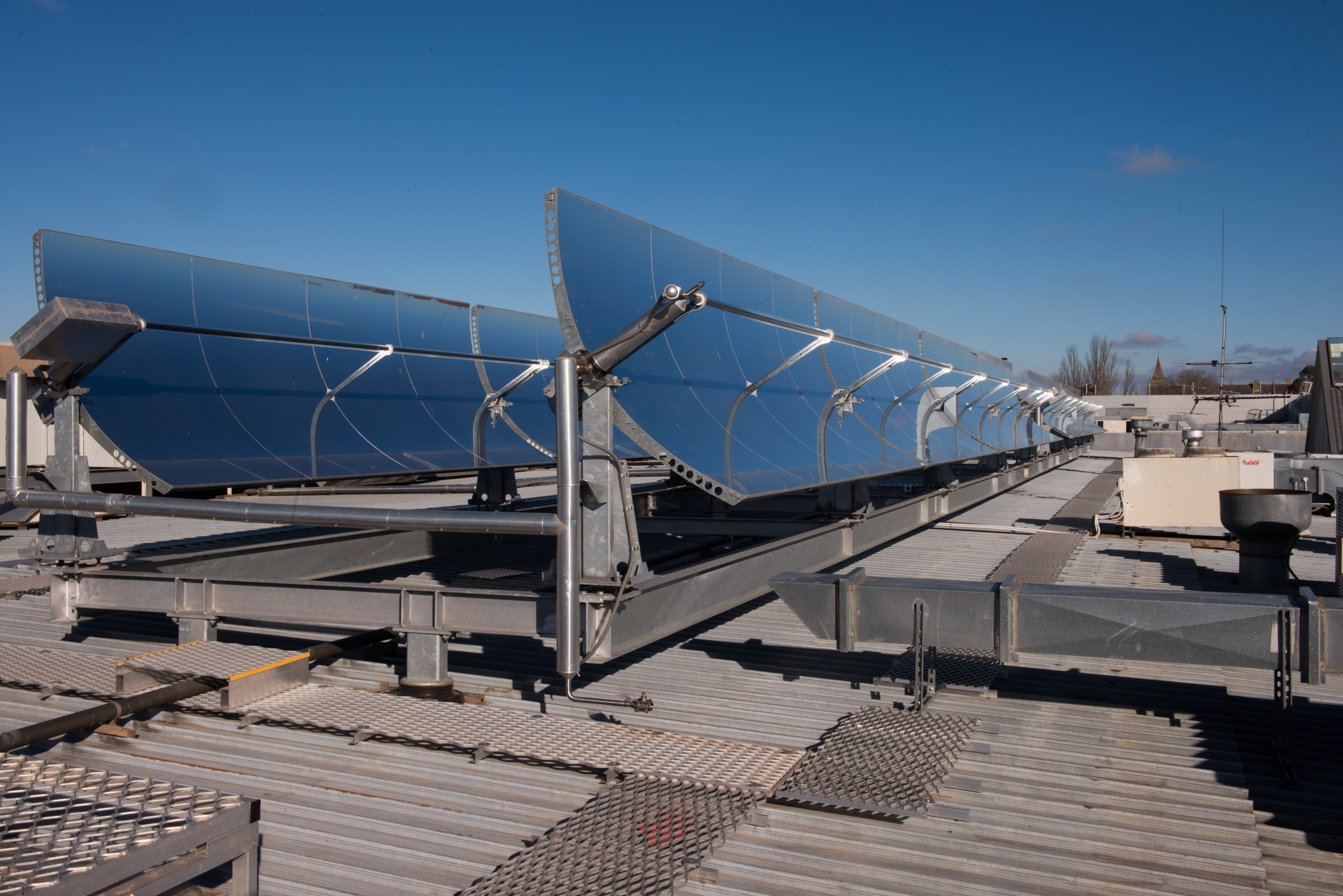 Rooftop concentrating solar thermal collectors