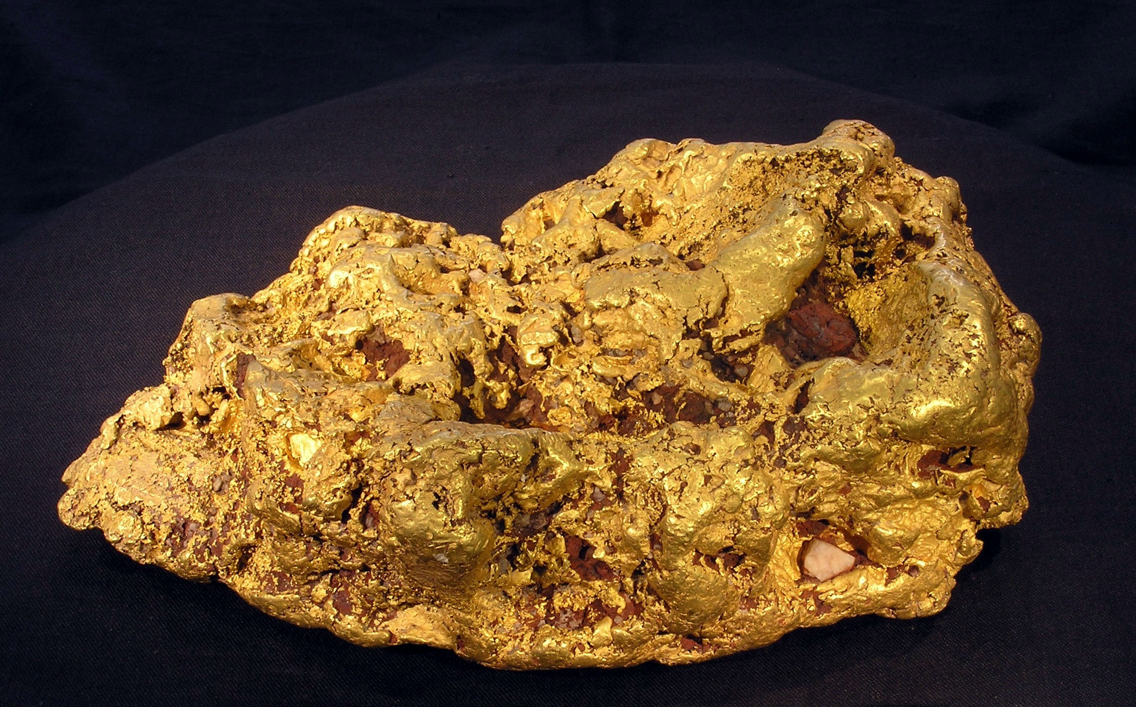 Gold nugget against a black background.