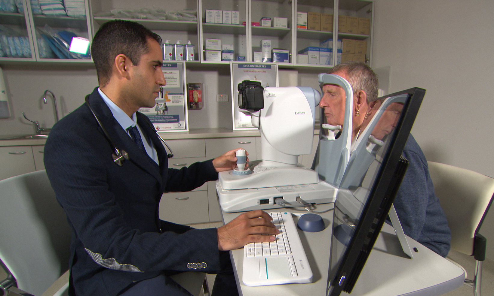 Dr Aly Khanbhai uses the new eye scanning tech on Midland patient.