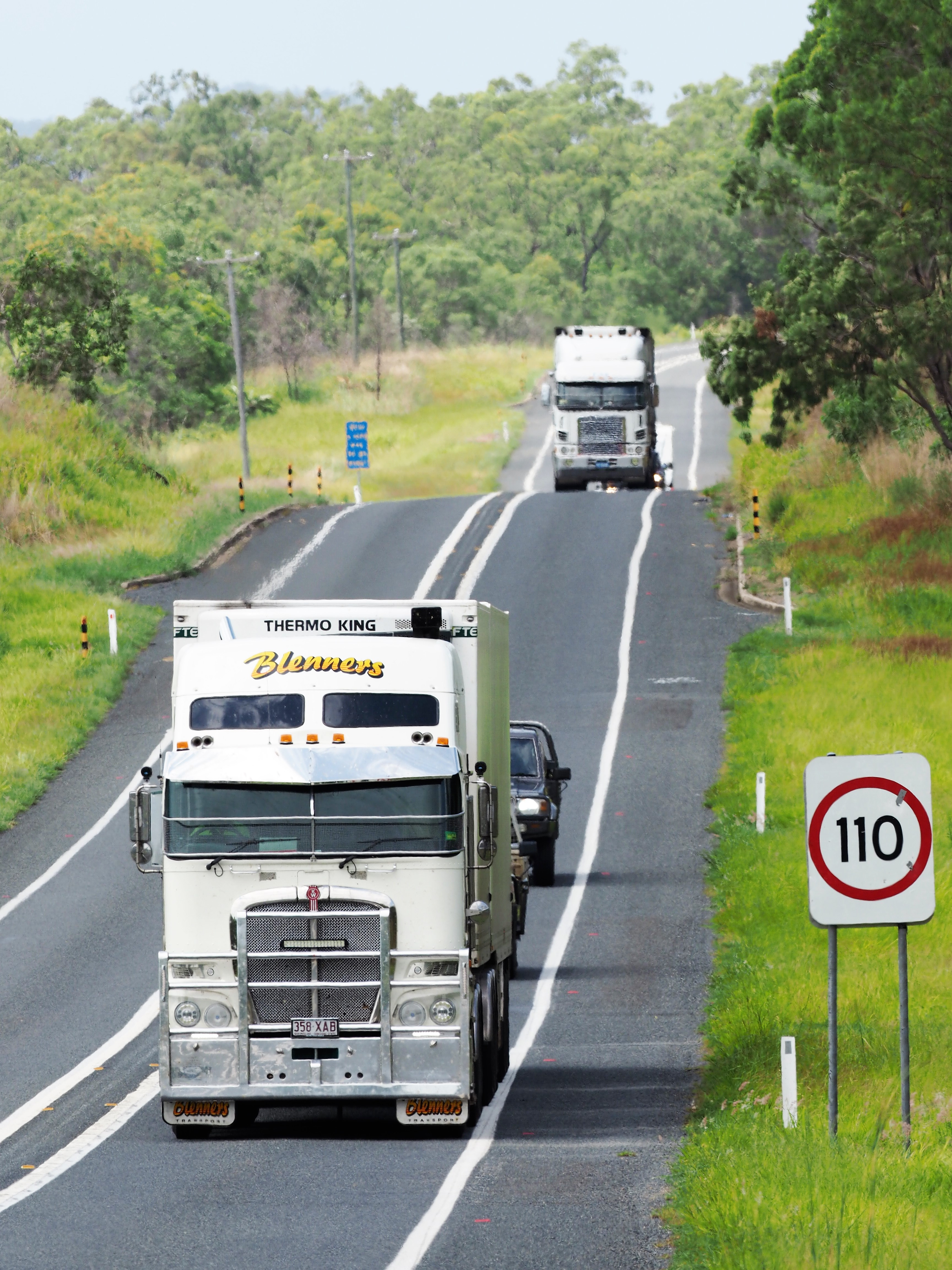 Trucks drining aling a highway in outback Australia.