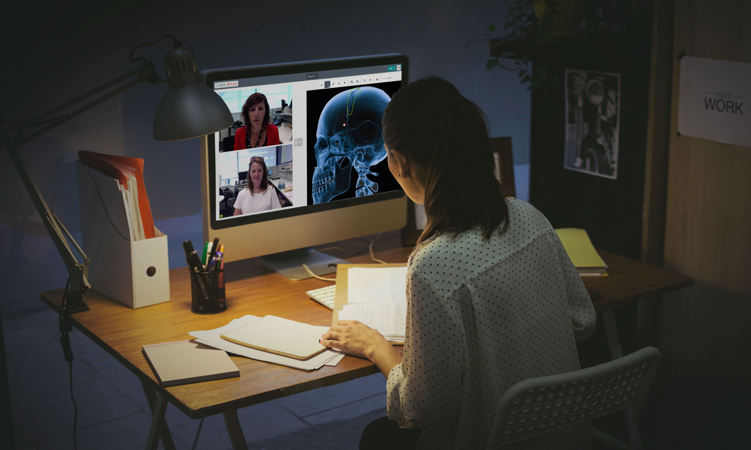 Person sitting at a desk using the Coviu video telehealth platform.