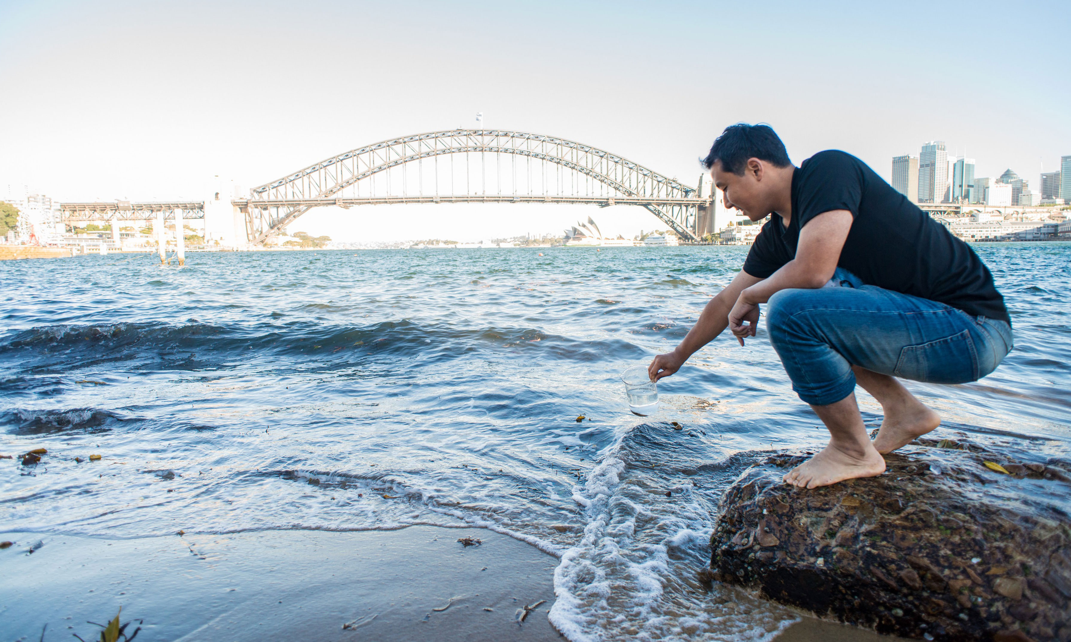 Dr Seo collecting a water sample from Sydney Harbour.