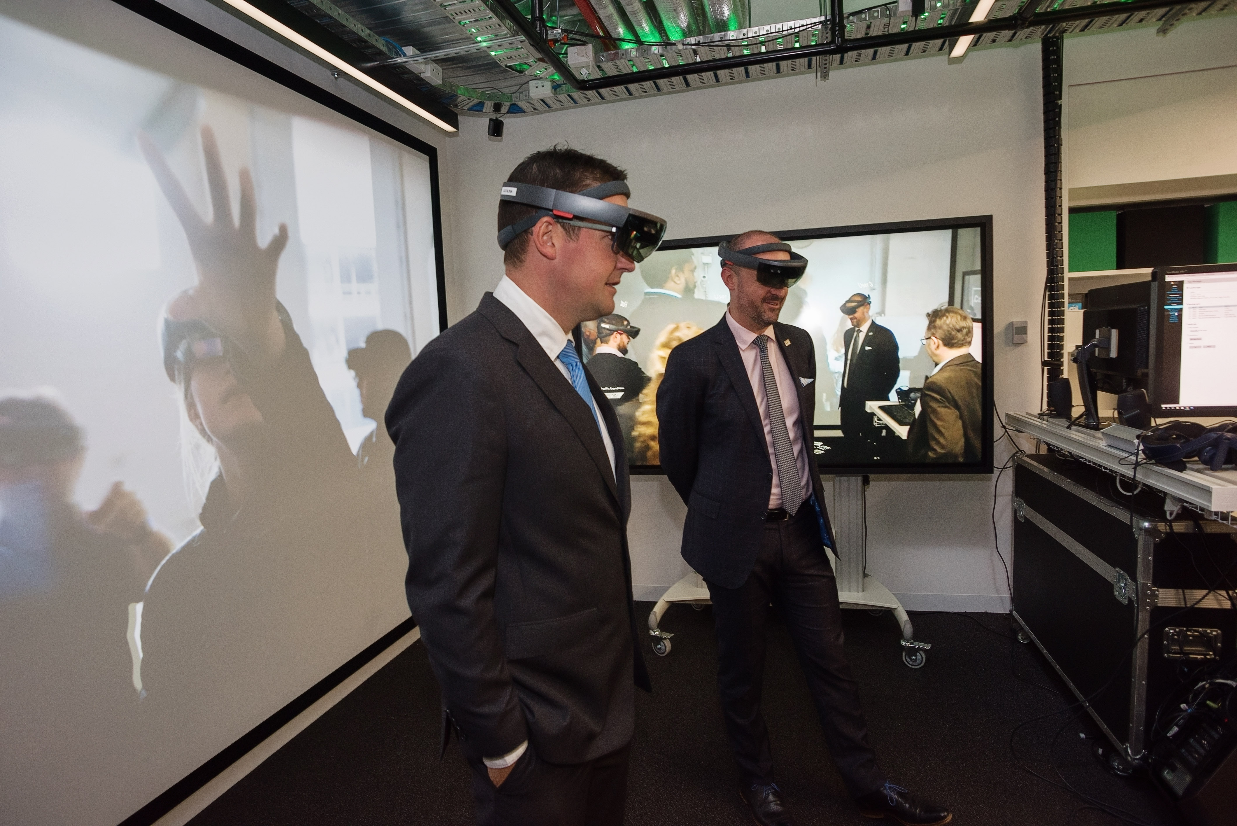 Minister Seselja and Minister Barr with headsets on, using the technology in the Immersive Environments Lab.