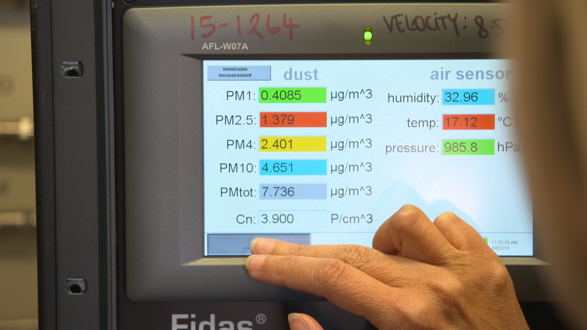 Close up of the screen of air quality monitoring equipment being used by a scientist.