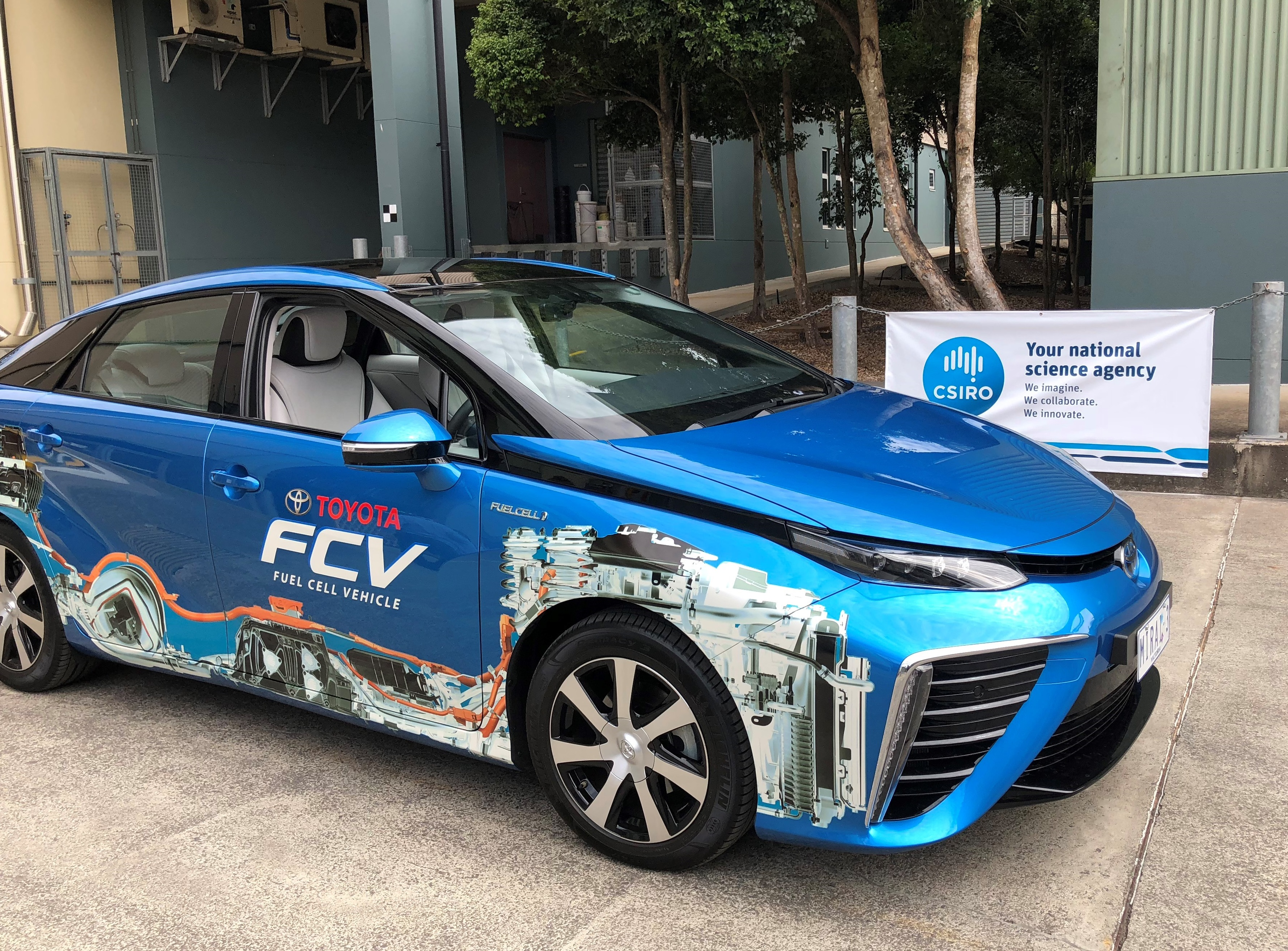 Toyota Mirai fuel cell vehicle sitting outside a CSIRO building.