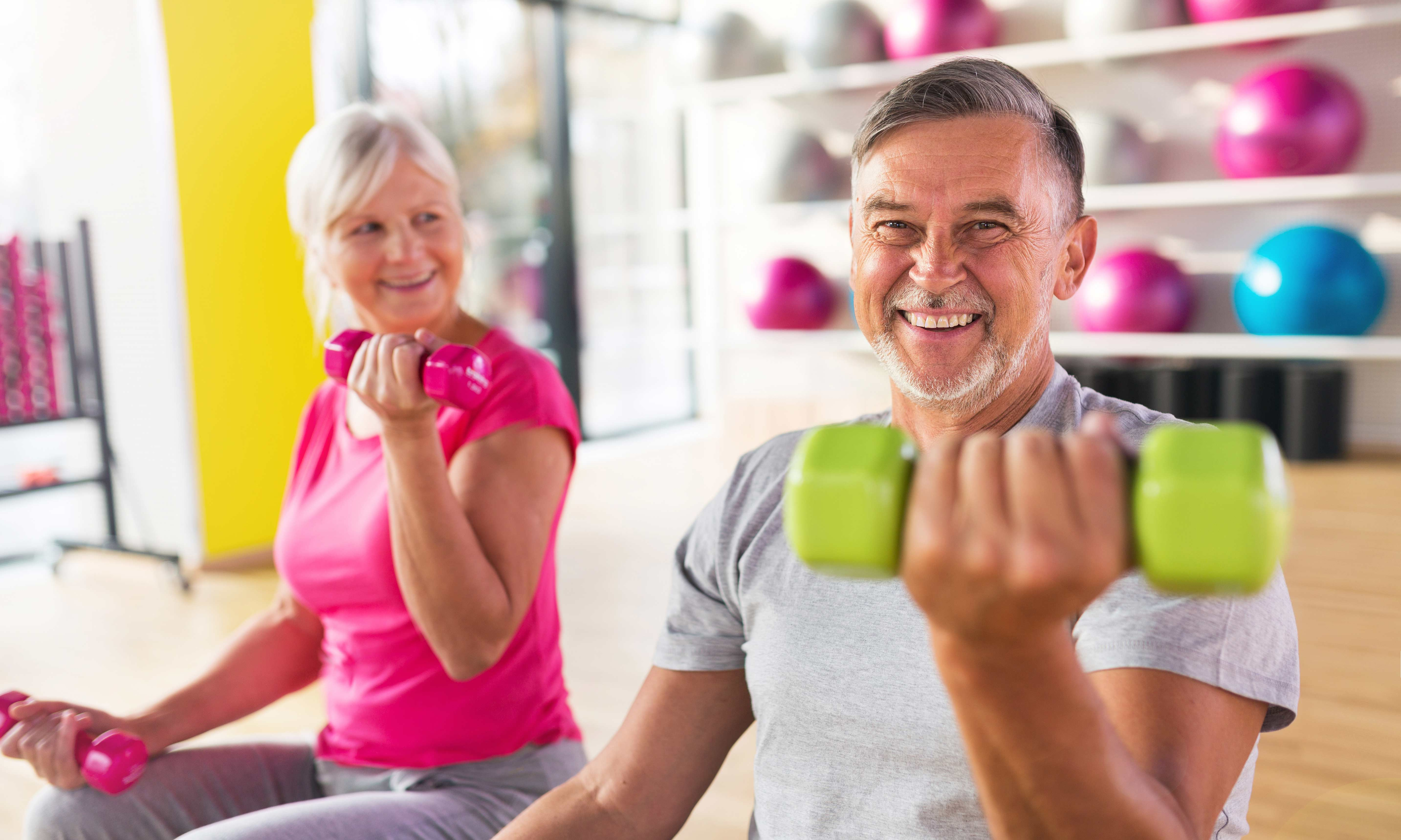 Two older people exercising.