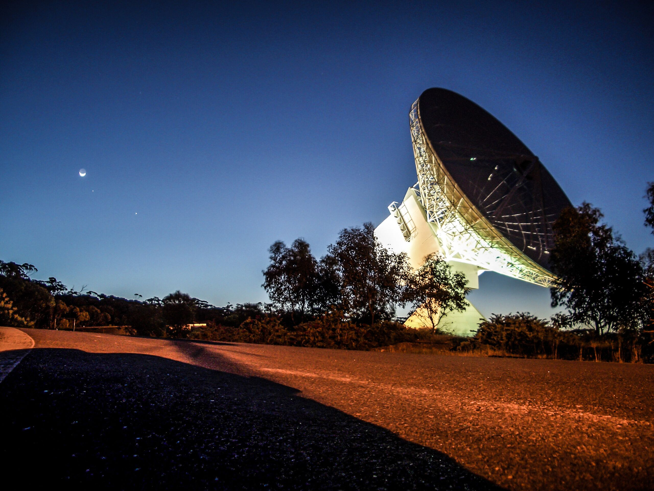Radio telescope at night.