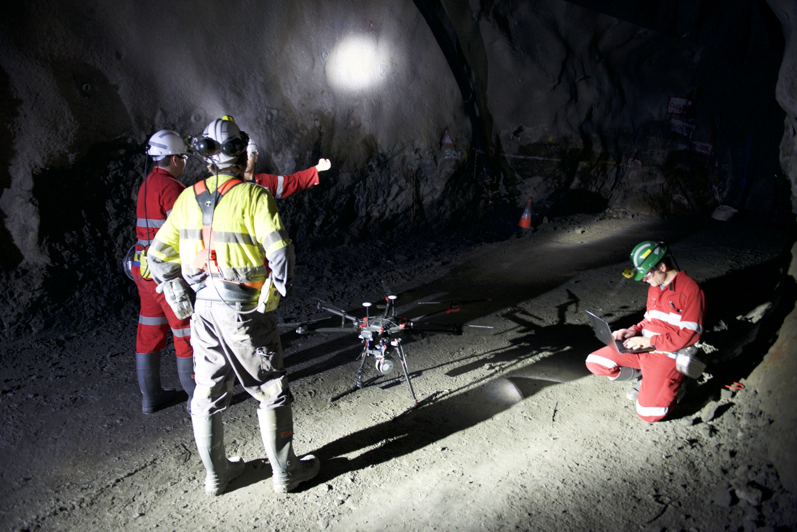 People underground setting up Emesents Hovermap to explore an underground mine.