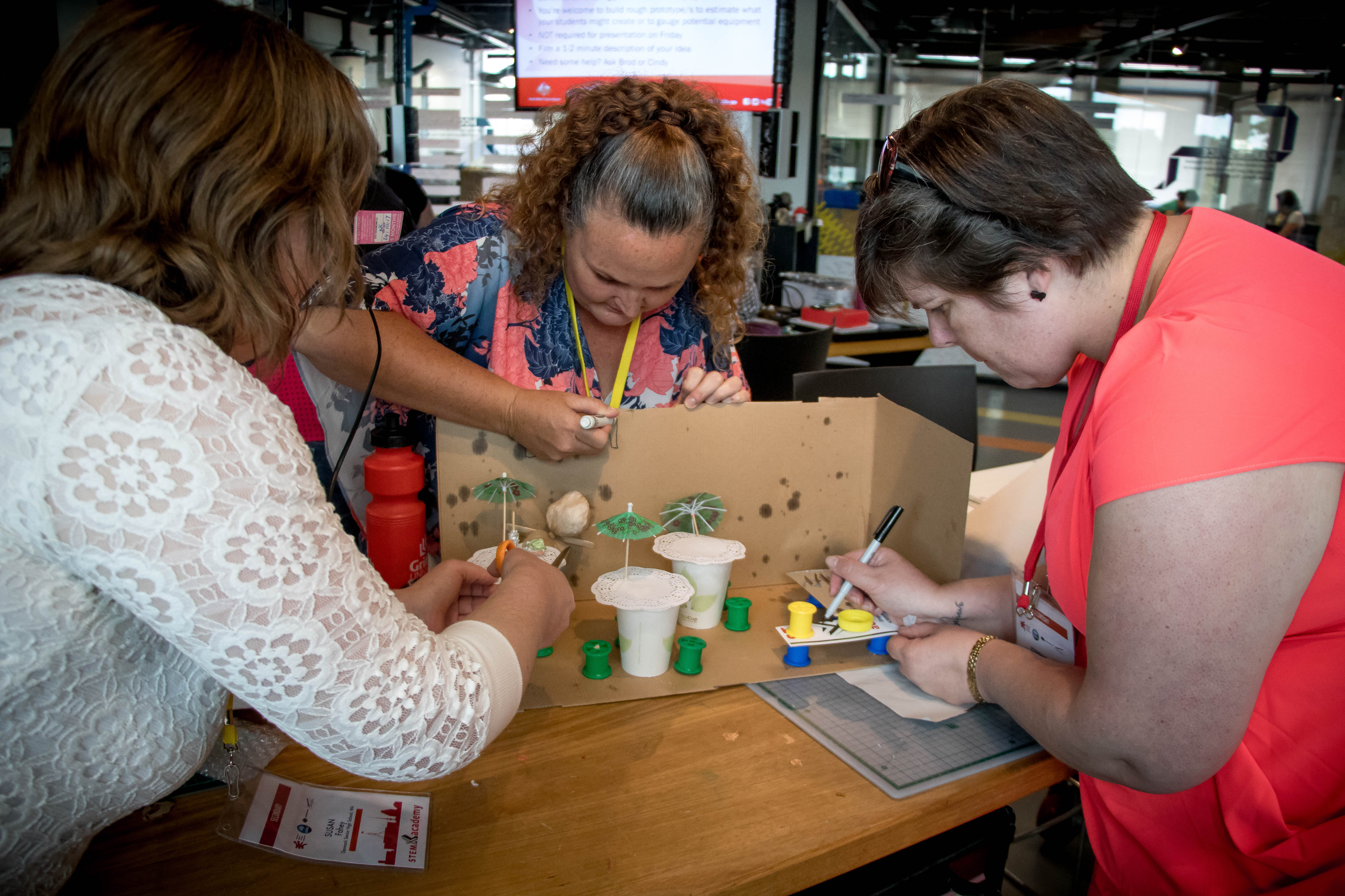 Susan Fahey from WA, Trudy Spargo from NSW and Kerensa Greenfield from SA collaborate on an activity at Questacon's Makerspace in Deakin.