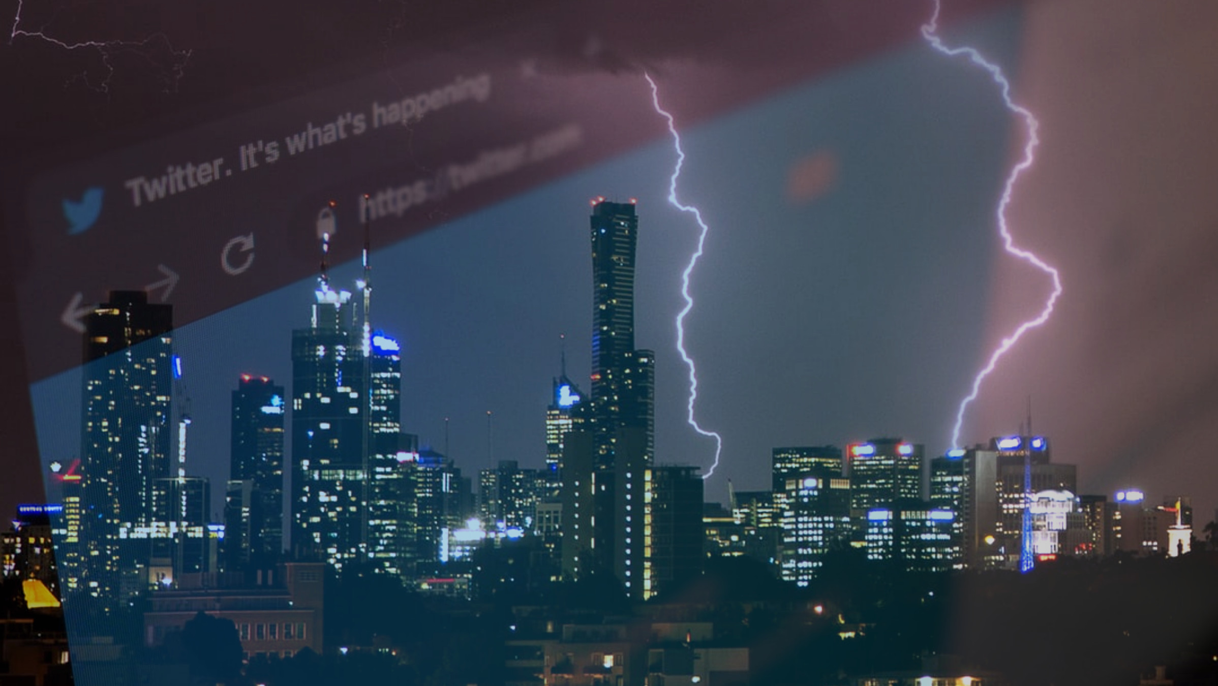 View of lightning stiking city buildings through a high rise window.