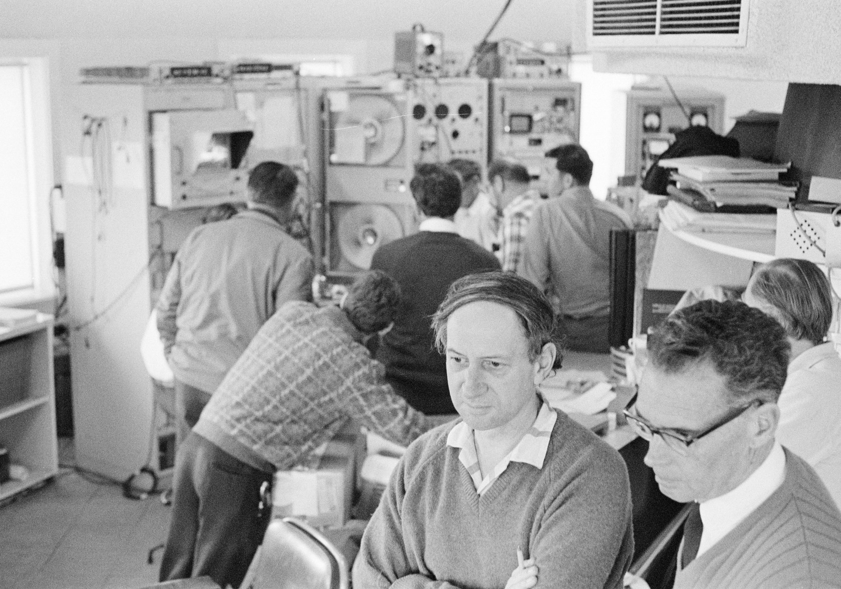 CSIRO staff watch the moon landing from within the Parkes radio telescope, on 21 July 1969.