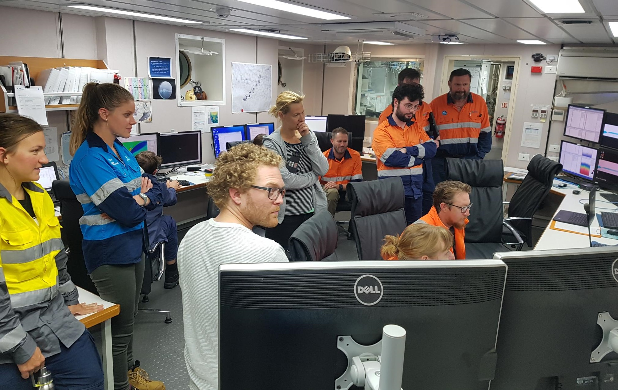 Science team watches survey in Operations Room.