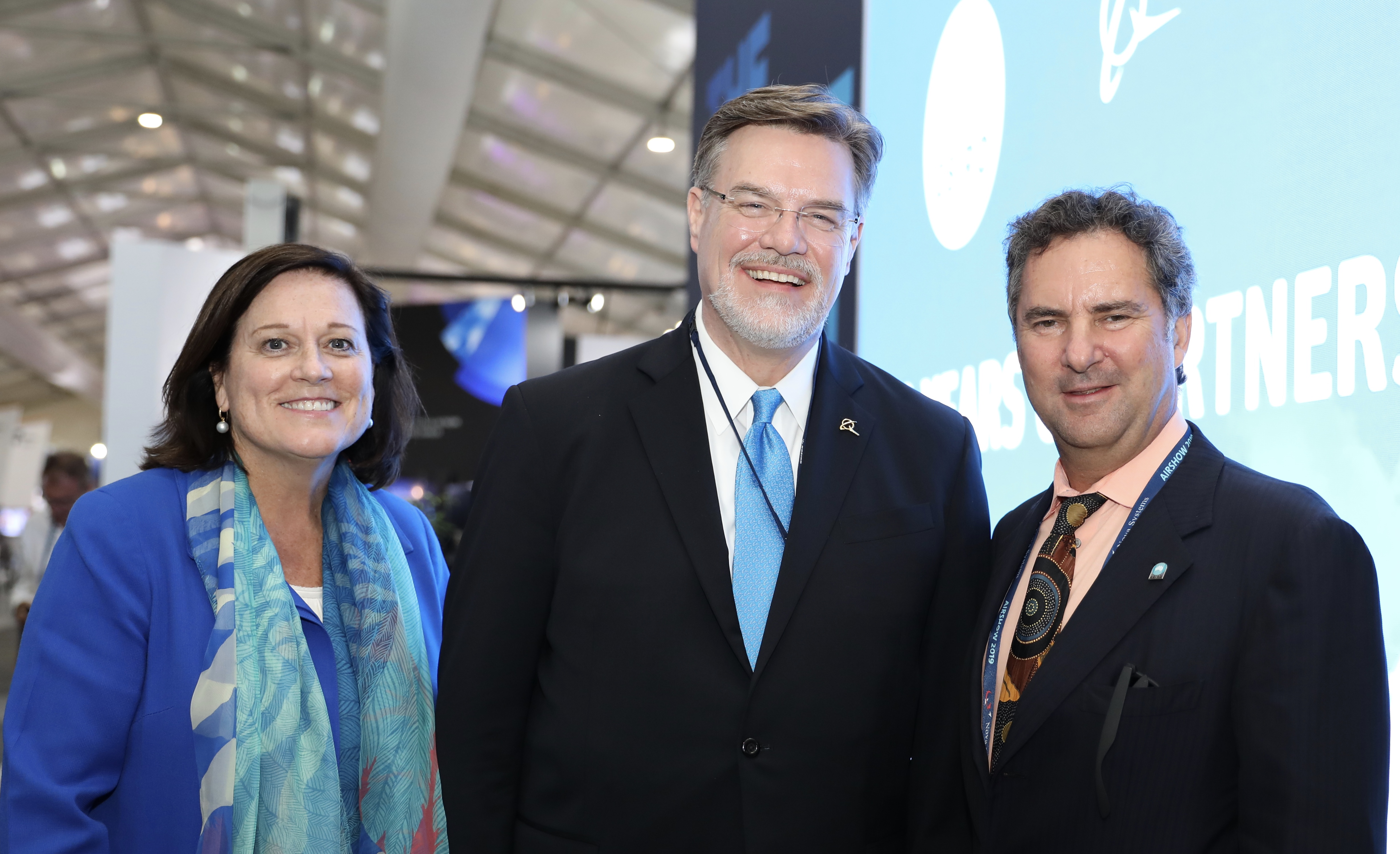 (L-R) Maureen Dougherty, Dr Greg Hyslop and Dr Larry Marshall standing together at the Boeing event.