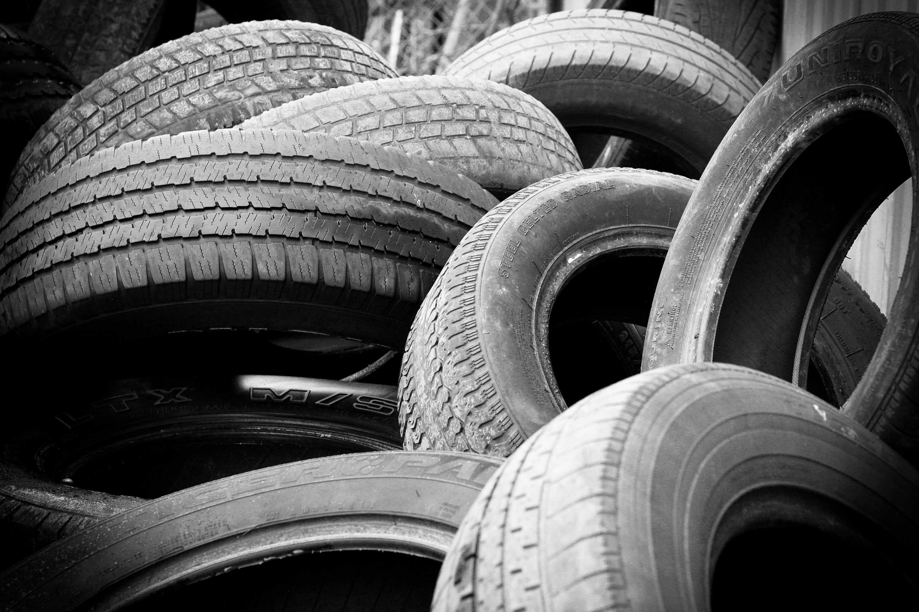 Old tyres dumped in a pile.
