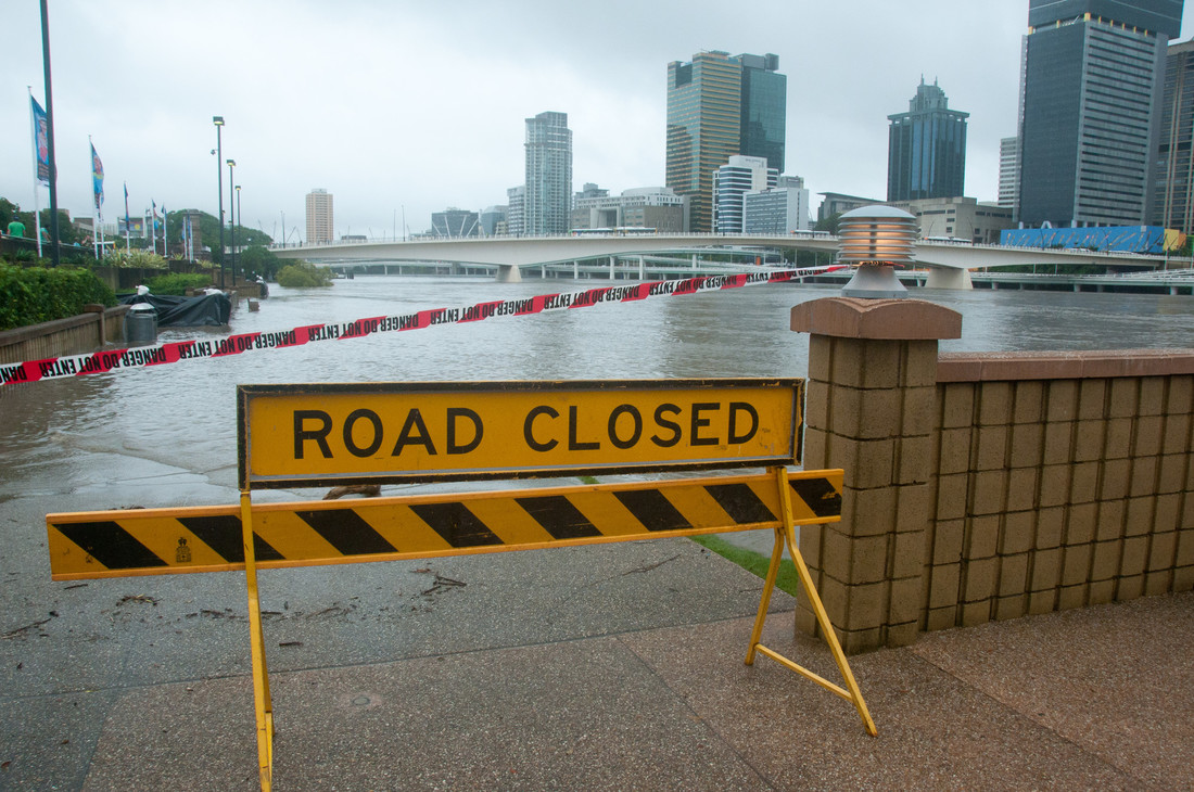 Road closed sign on walkway during Brisbane River flood