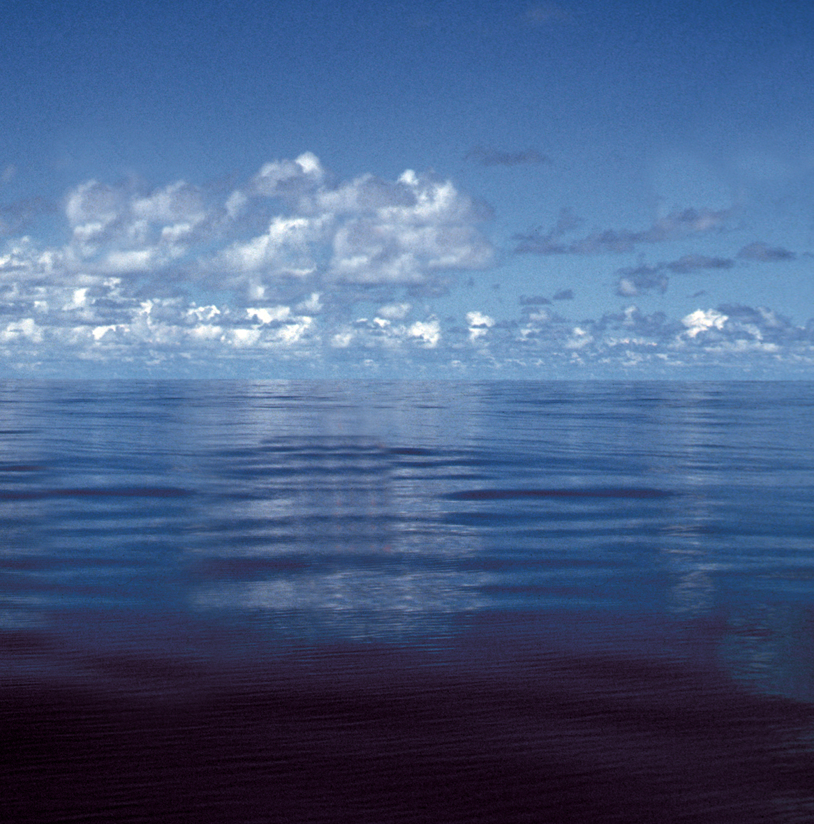 calm ocean with cloudy sky