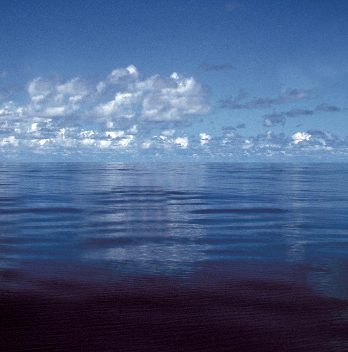 calm ocean with cloudy sky