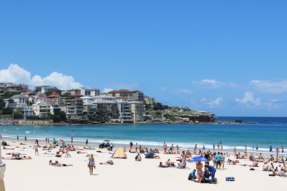 Bondi Beach featuring the ocean and people at the beach on the sand