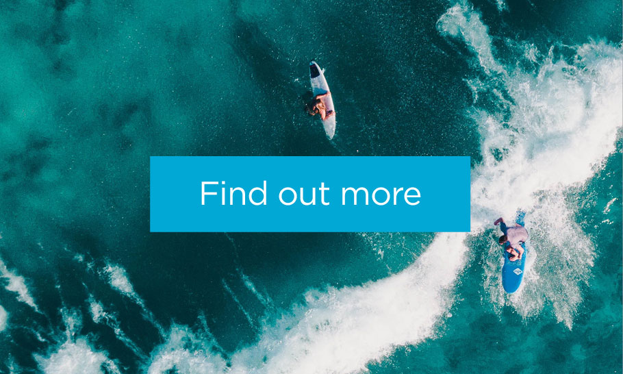 Overhead shot of Australian surfers with the words Find out more overlaid on the image.